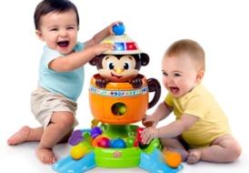 Развивающая игрушка «Обезьянка в бочке» Bright Starts